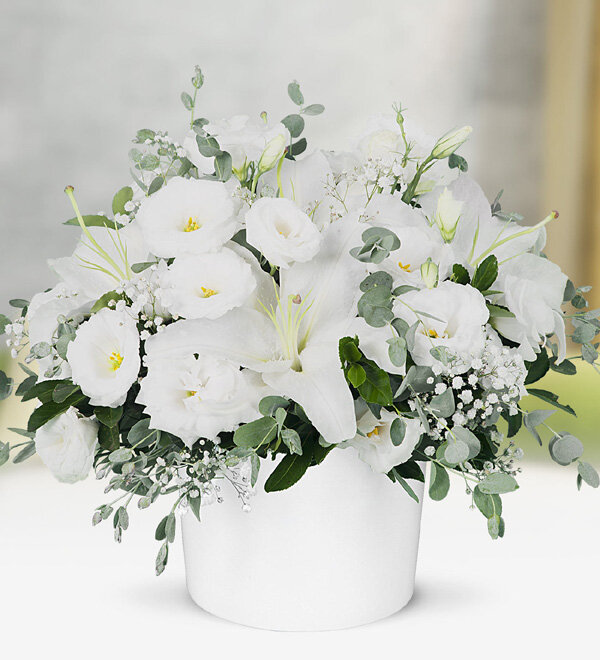 Lilies and Lisianthus in Ceramic Vase